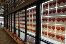 hallway window covered in paper with hearts with names written on them