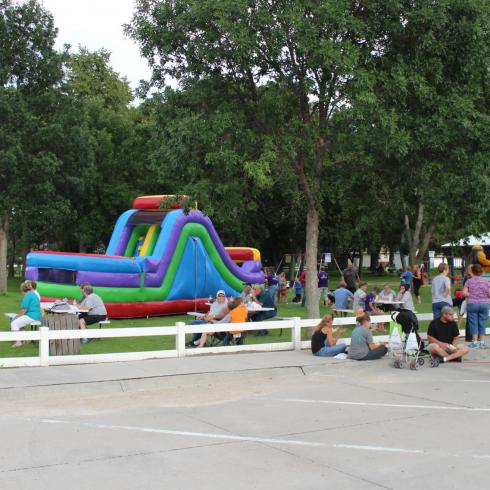 Atkinson City Park with Bounce Houses and crowd