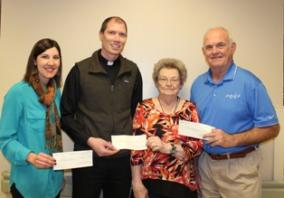 Jessica Prussa of West Holt Medical Services Foundation, Fr. James Weeder of St. Joseph's Catholic Church, Phyllis Langan, and Doug Kubik of The Atkinson-Stuart Country Club