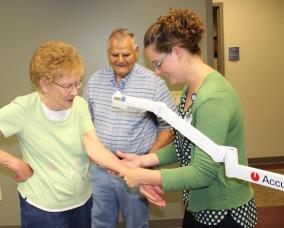 chief nursing officer Tana O'Neill demonstrates AccuVein Equipment